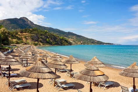 1row_of_straw_umbrellas_and_lounges_at_sandy_beach_of_zakynthos_greece._shutterstock_142721089